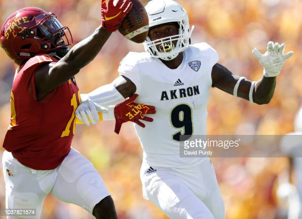 Defensive back Brian Peavy of the Iowa State Cyclones breaks up a pass meant for wide receiver Jonah Morris of the Akron Zips in the first half of...