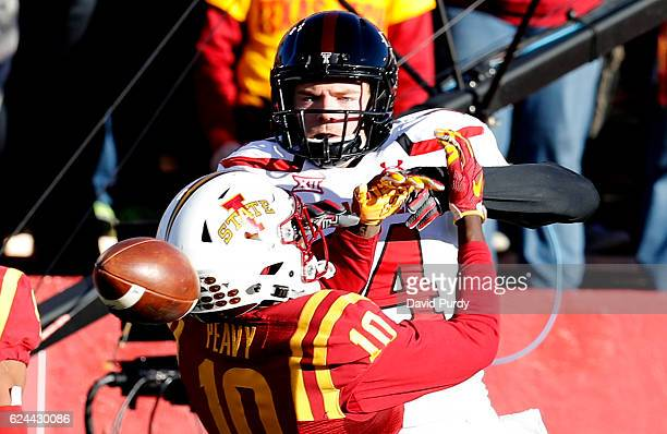 Defensive back Brian Peavy of the Iowa State Cyclones breaks up a pass meant for wide receiver Dylan Cantrell of the Texas Tech Red Raiders in the...