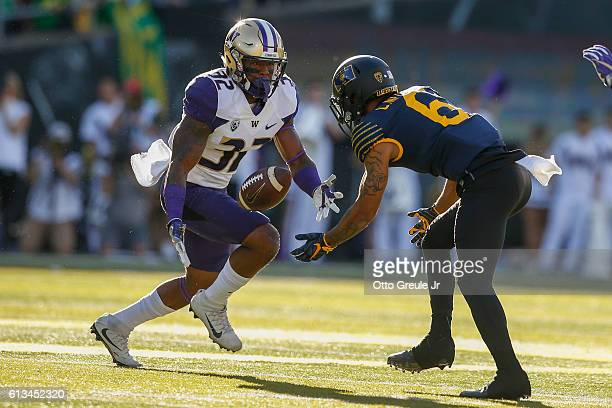 Defensive back Budda Baker of the Washington Huskies intercepts a pass against wide receiver Charles Nelson of the Oregon Ducks on October 8 2016 at...