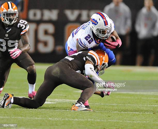 Defensive back Buster Skrine of the Cleveland Browns tackles running back Fred Jackson of the Buffalo BIlls during a game against the Buffalo Bills...