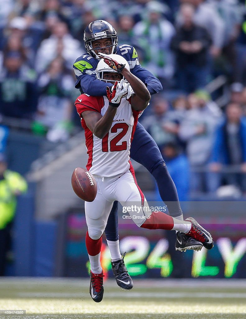 Defensive back Byron Maxwell #41 of the Seattle Seahawks defends a pass against wide receiver John Brown #12 of the Arizona Cardinals at CenturyLink Field on November 23, 2014 in Seattle, Washington. The Seahawks defeated the Cardinals 19-3.