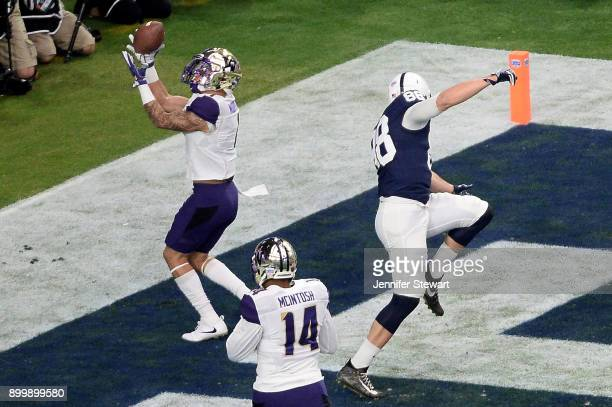 Defensive back Byron Murphy of the Washington Huskies makes an interception touchback against tight end Mike Gesicki of the Penn State Nittany Lions...