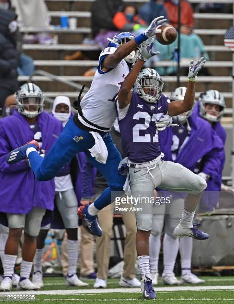 Defensive back Cameron Key of the Kansas State Wildcats brakes up a pass intended for wide receiver Ezra Naylor II of the Kansas Jayhawks during the...