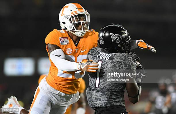 Defensive back Cameron Sutton of the Tennessee Volunteers breaks up a pass intended for wide receiver Isaiah Ford of the Virginia Tech Hokies in the...