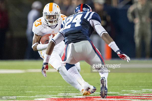 Defensive back Cameron Sutton of the Tennessee Volunteers looks to maneuver by linebacker Keith Lewis of the Mississippi Rebels on October 18 2014 at...