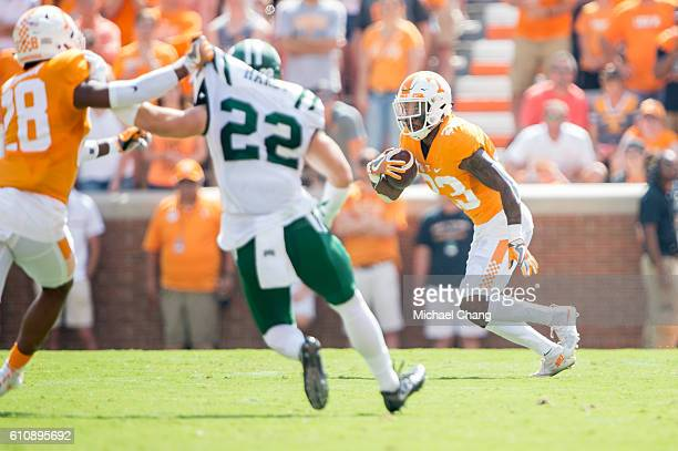 Defensive back Cameron Sutton of the Tennessee Volunteers looks to maneuver the ball by safety Bo Hardy of the Ohio Bobcats at Neyland Stadium on...