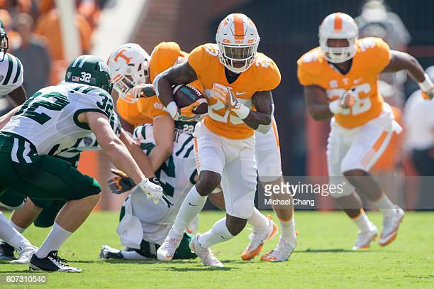 Defensive back Cameron Sutton of the Tennessee Volunteers runs the ball past linebacker Quentin Poling of the Ohio Bobcats at Neyland Stadium on...