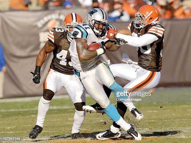 Defensive back Captain Munnerlyn of the Carolina Panthers is tackled by defensive back Eric King of the Cleveland Browns while returning a kickoff as...