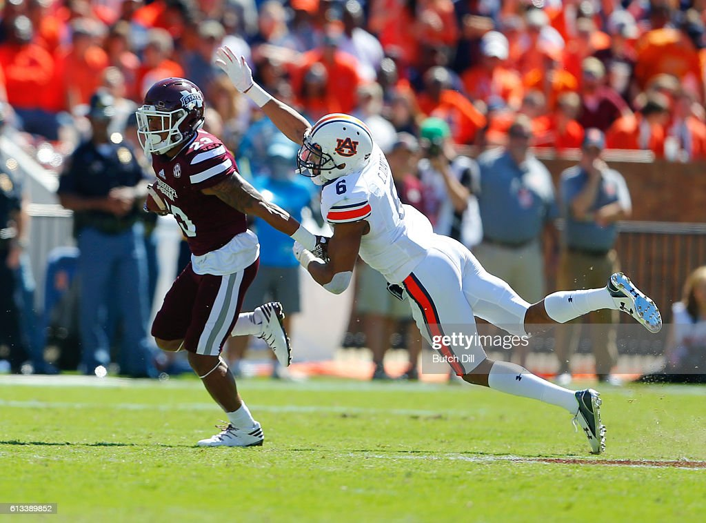 Defensive back Carlton Davis #6 of the Auburn Tigers tries to tackle wide receiver Keith Mixon #23 of the Mississippi State Bulldogs as he runs during the second half of an NCAA college football game on Oct. 8, 2016 in Starkville, Mississippi. Auburn won 38-14.