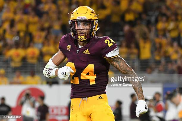 Defensive back Chase Lucas of the Arizona State Sun Devils celebrates after sacking quarterback quarterback DJ Gillins of the UTSA Roadrunners in the...