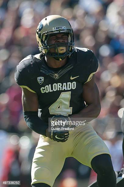 Defensive back Chidobe Awuzie of the Colorado Buffaloes celebrates a defensive stop against the Stanford Cardinal at Folsom Field on November 7 2015...