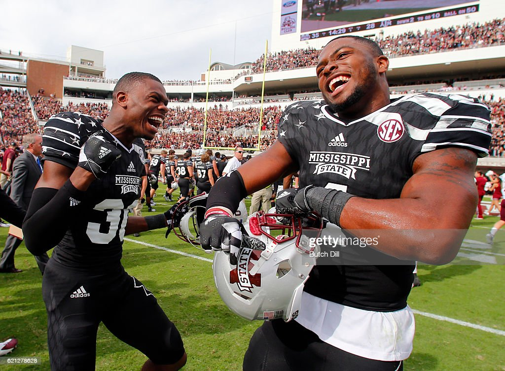 Defensive back Chris Stamps #30 of the Mississippi State Bulldogs celebrates with linebacker Gerri Green #4 of the Mississippi State Bulldogs after the end of an NCAA college football game at Davis Wade Stadium on November 5, 2016 in Starkville, Mississippi. Mississippi State beat the Texas A&M Aggies 35-28.