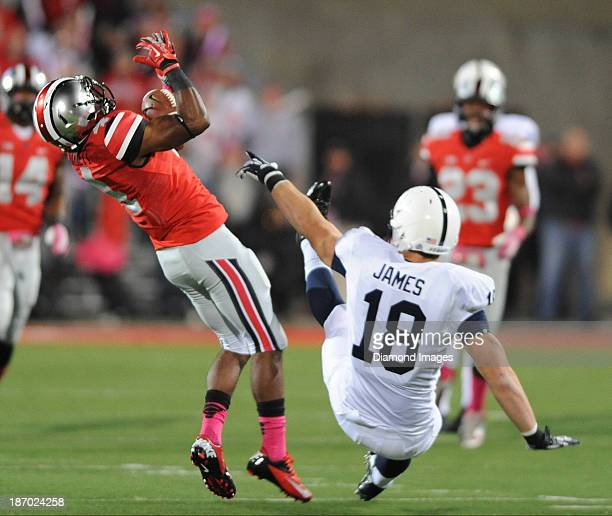 Defensive back C.J. Barnett of the Ohio State Buckeyes intercepts a pass during a game against the Penn State Nittany Lions at Ohio Stadium in...