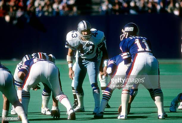 Defensive back Cliff Harris of the Dallas Cowboys looks to blitz quarterback Phil Simms of the New York Giants during an NFL football game November...