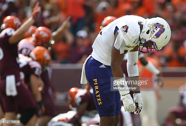 Defensive back Colby Gore of the East Carolina Pirates reacts following a muffed punt against the Virginia Tech Hokies late in the fourth quarter at...