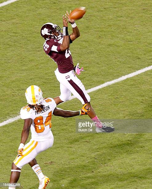Defensive back Corey Broomfield of the Mississippi State Bulldogs intercepts a pass intended for wide receiver Cordarrelle Patterson of the Tennessee...