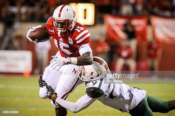 Defensive back Corn Elder of the Miami Hurricanes tackles wide receiver De'Mornay Pierson-El of the Nebraska Cornhuskers during their game at...