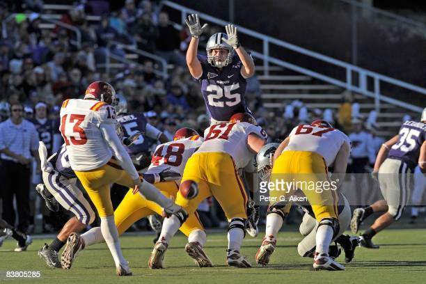 Defensive back Craig Boswell of the Kansas State Wildcats leaps into the air in an attempt to block the punt of punter Mike Brandtner of the Iowa...
