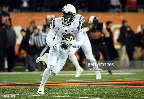 Defensive back Damarious Randall of the Arizona State Sun Devils run back an interception during the first quarter of the game against the Oregon...