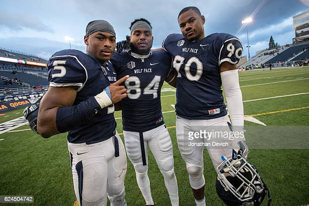 Defensive back Dameon Baber and teammates wide receiver Jerico Richardson and defensive end Malik Reed all of the Nevada Wold Pack happy after the...
