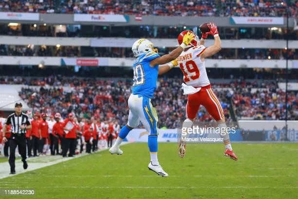 Defensive back Daniel Sorensen of the Kansas City Chiefs intercepts a pass intended for running back Austin Ekeler of the Los Angeles Chargers in the...