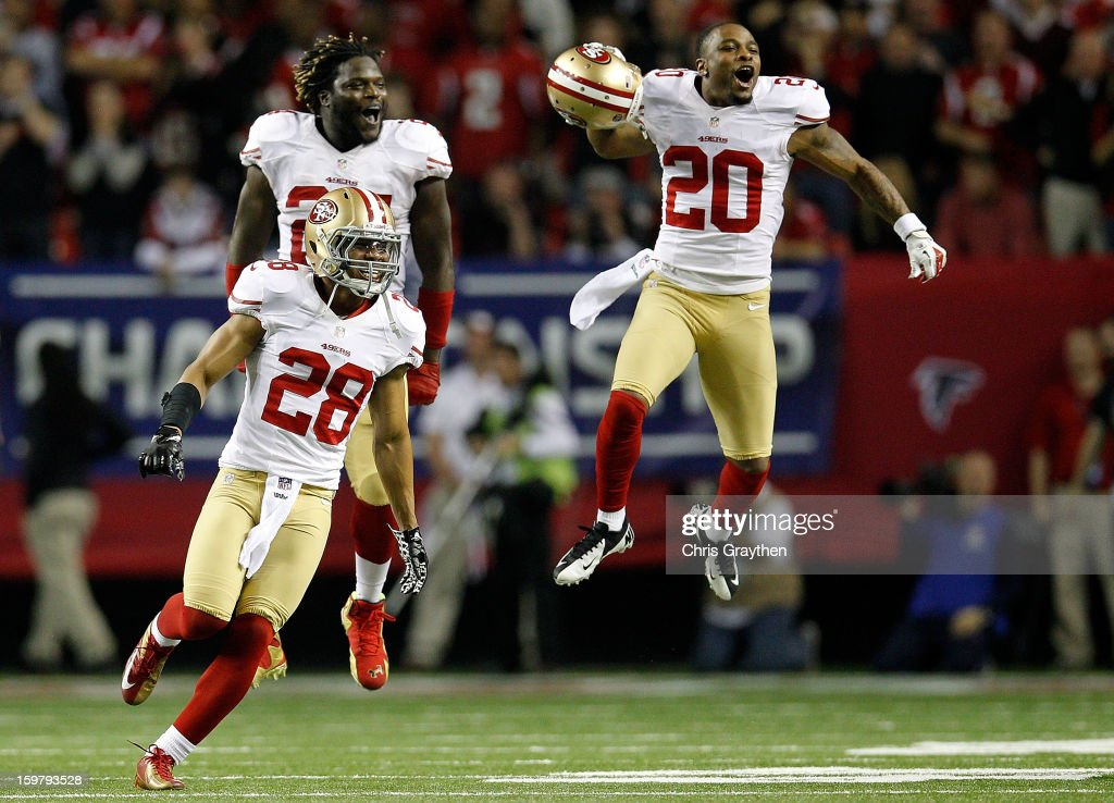 Defensive back Darcel McBath #28, Anthony Dixon #24 and defensive back Perrish Cox #20 of the San Francisco 49ers react after stopping the Atlanta Falcons on fourth down in the fourth quarter in the NFC Championship game at the Georgia Dome on January 20, 2013 in Atlanta, Georgia.