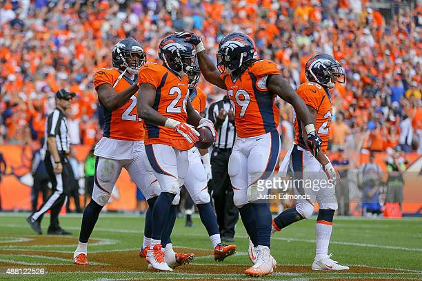 Defensive back Darian Stewart of the Denver Broncos celebrates with Danny Trevathan and Aqib Talib after making a game-ending interception in the...