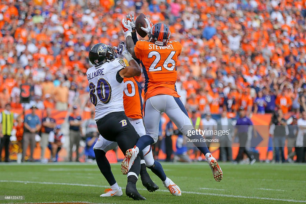 Defensive back Darian Stewart #26 of the Denver Broncos makes a game-ending interception on a pass intended for tight end Crockett Gillmore #80 of the Baltimore Ravens in the end zone in the fourth quarter of a game at Sports Authority Field at Mile High on September 13, 2015 in Denver, Colorado. strong safety David Bruton #30 of the Denver Broncos also defended on the play.