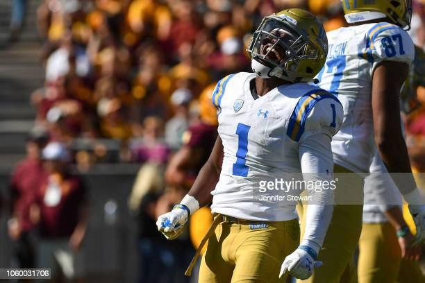 Defensive back Darnay Holmes of the UCLA Bruins celebrates after returing an interception for a 31 yard touchdown in the first half against the...