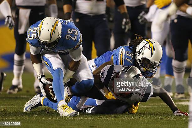 Defensive back Darrell Stuckey of the San Diego Chargers recovers a fumble by wide receiver Brandon LaFell of the New England Patriots at Qualcomm...
