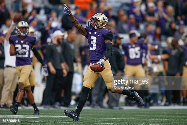 Defensive back Darren Gardenhire of the Washington Huskies points to the crowd after making an interception against the Oregon State Beavers on...