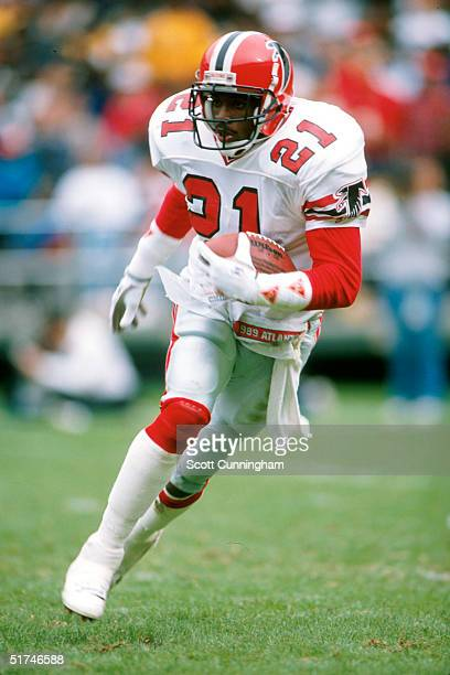 Defensive back Deion Sanders of the Atlanta Falcons heads upfield on a punt return in a 26 to 17 loss to the New Orleans Saints on