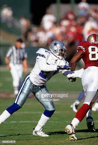 Defensive back Deion Sanders of the Dallas Cowboys in action guarding wide receiver JJ Stokes of the San Francisco 49ers November 10 1996 during an...