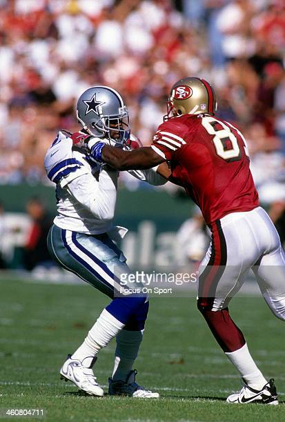 Defensive back Deion Sanders of the Dallas Cowboys in action guarding wide receiver Terrell Owens of the San Francisco 49ers November 10 1996 during...