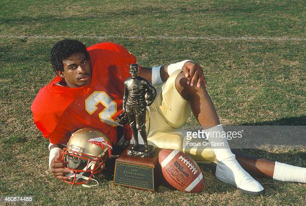 Defensive back Deion Sanders of the Florida State Seminoles winner of the 1988 Jim Thorpe Award, poses with the trophy circa 1988 at Doak Campbell...