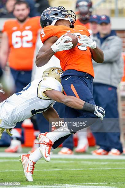 Defensive back Demond Smith of the Georgia Tech Yellow Jackets hits wide receiver Canaan Severin of the Virginia Cavaliers on November 1 2014 at...