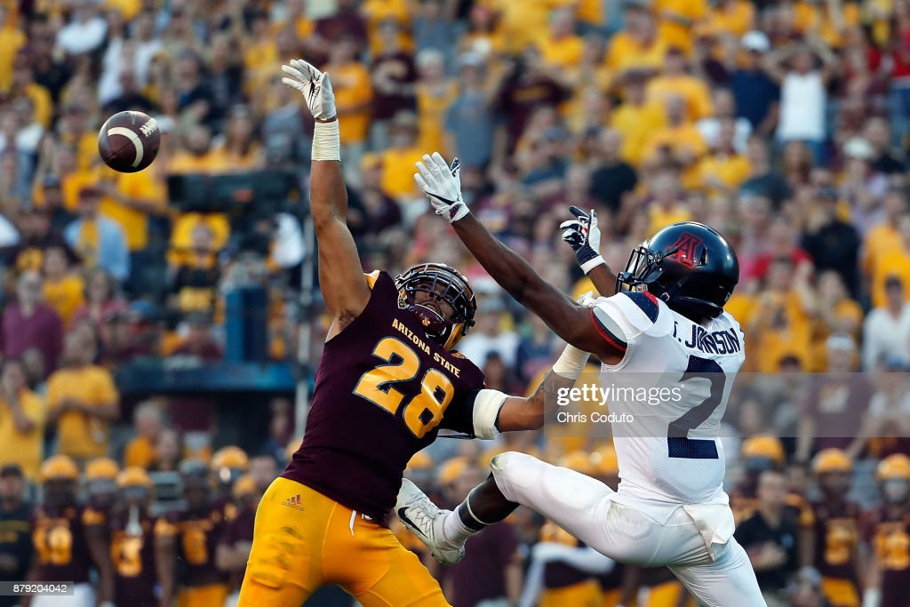 Defensive back Demonte King #28 of the Arizona State Sun Devils breaks up a pass intended for wide receiver Tyrell Johnson #2 of the Arizona Wildcats during the second half of the college football game at Sun Devil Stadium on November 25, 2017 in Tempe, Arizona. The Sun Devils beat the Wildcats 42-30.