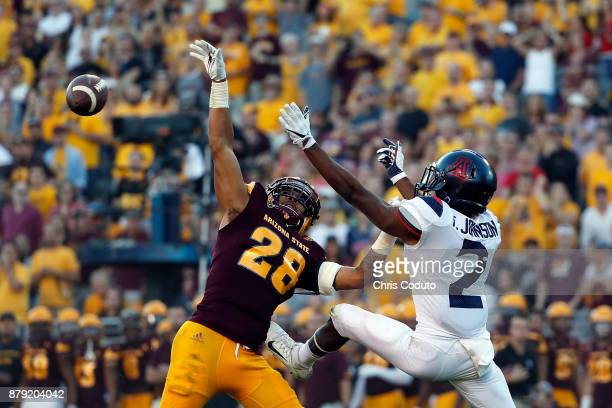 Defensive back Demonte King of the Arizona State Sun Devils breaks up a pass intended for wide receiver Tyrell Johnson of the Arizona Wildcats during...