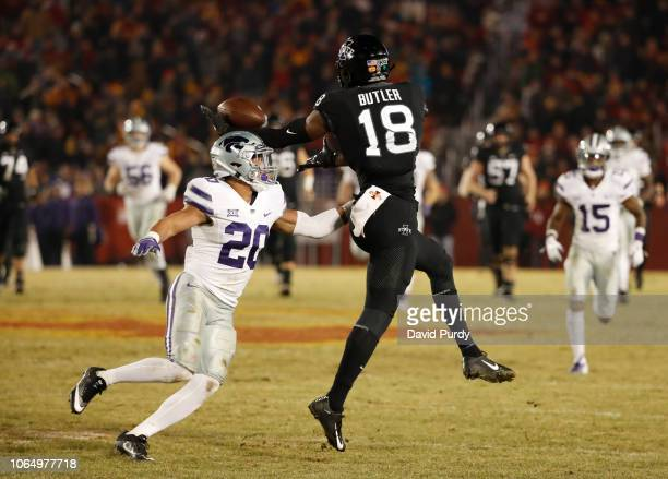 Defensive back Denzel Goolsby of the Kansas State Wildcats breaks up a pass mean for wide receiver Hakeem Butler of the Iowa State Cyclones in the...