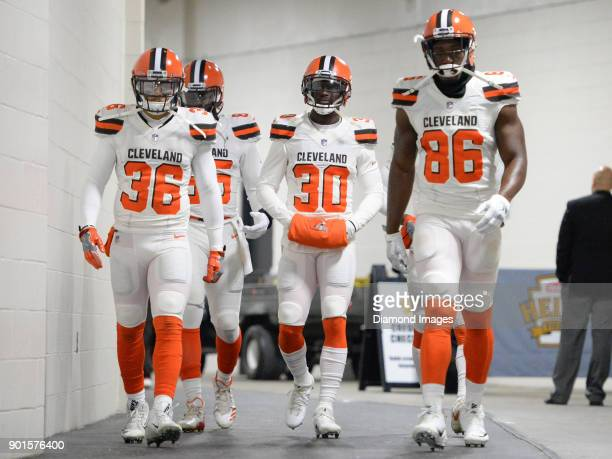 Defensive back Derron Smith tight end David Njoku cornerback Jason McCourty and tight end Randall Telfer of the Cleveland Browns walk down the tunnel...