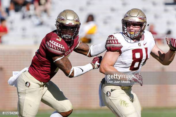 Defensive Back Derwin James covers Tight End Ryan Izzo of the Florida State Seminoles on a pass play during the annual Garnet and Gold Spring...