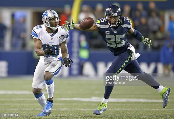 Defensive back DeShawn Shead of the Seattle Seahawks breaks up a pass intended for Wide receiver Anquan Boldin of the Detroit Lions in the NFC Wild...