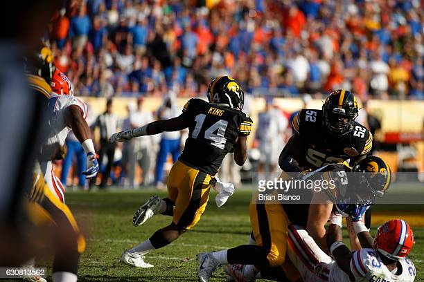Defensive back Desmond King of the Iowa Hawkeyes finds room to run on the punt return during the fourth quarter of the Outback Bowl NCAA college...