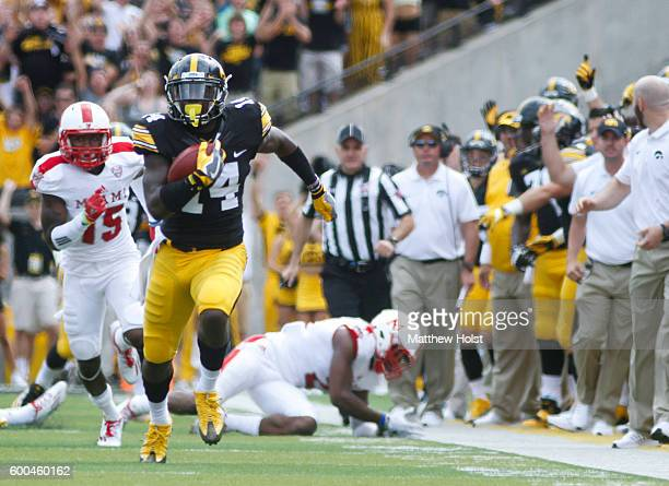 Defensive back Desmond King of the Iowa Hawkeyes rushes up field on a kick return during the first quarter against the Miami of Ohio Redbirds on...