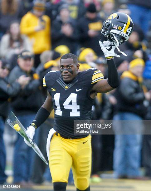 Defensive back Desmond King of the Iowa Hawkeyes takes the field after being announced on senior day before the matchup against the Nebraska...