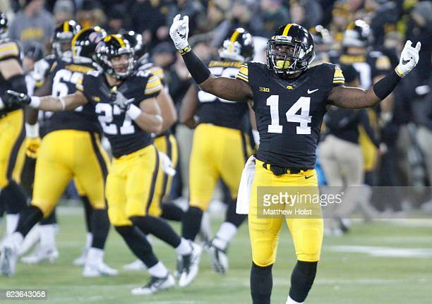 Defensive back Desmond King of the Iowa Hawkeyes tries to fire up the crowd during the first quarter against the Michigan Wolverines on November 12...