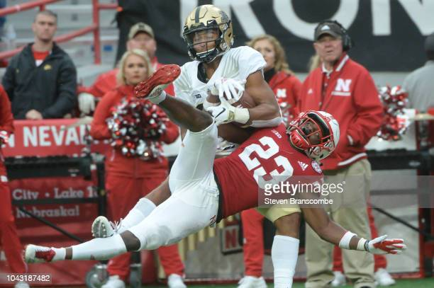 Defensive back Dicaprio Bootle of the Nebraska Cornhuskers defends against wide receiver Jared Sparks of the Purdue Boilermakers at Memorial Stadium...
