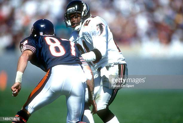 Defensive back Dion Sanders of the Atlanta Falcons guards Tom Waddle of the Chicago Bears during an NFL football game September 27 1992 at Soldier...