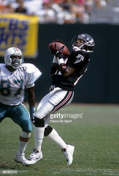 Defensive back Dion Sanders of the Atlanta Falcons plays catches a punt against the Miami Dolphins October 11 1992 during an NFL football game at Joe...