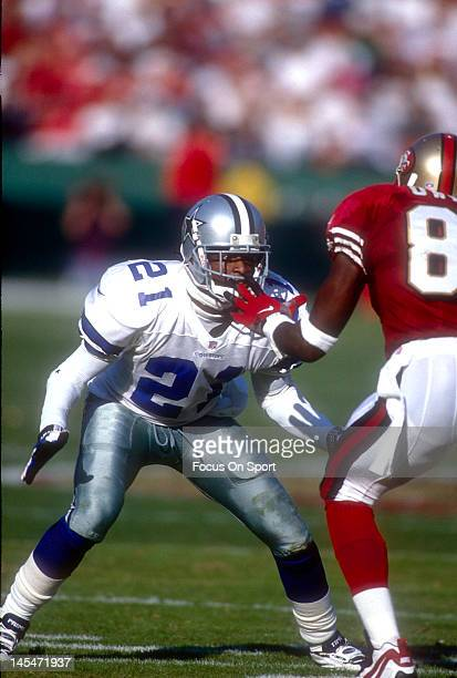 Defensive back Dion Sanders of the Dallas Cowboys in action guarding wide receiver JJ Stokes of the San Francisco 49ers November 10 1996 during an...